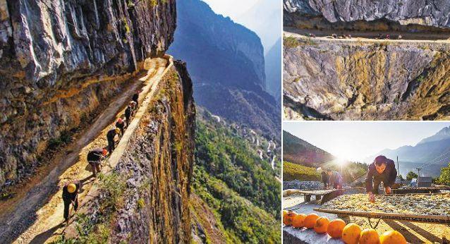 重慶懸崖村絕壁上鑿出致富路